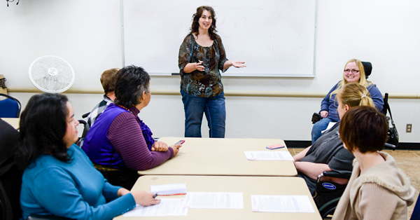 People meeting in a classroom environment.