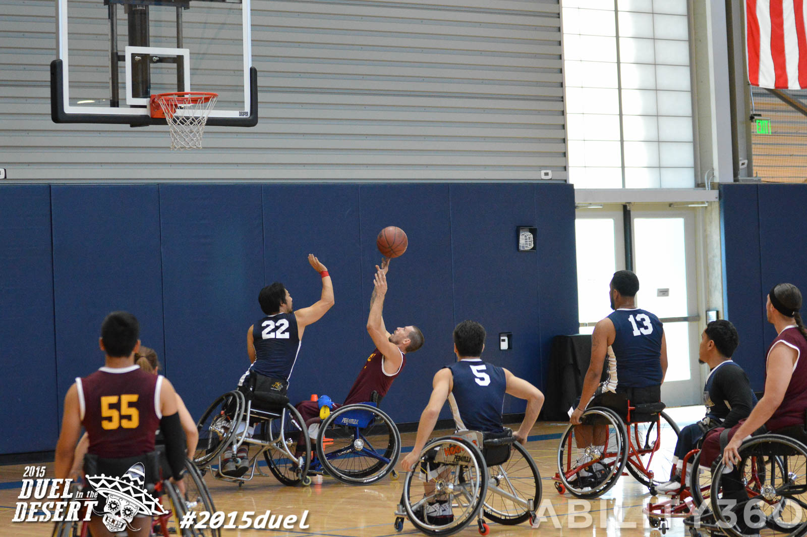 wheelchair basketball. opponent attempts to block a shot