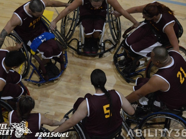 team huddle. in a circle. hands on each others sport chair