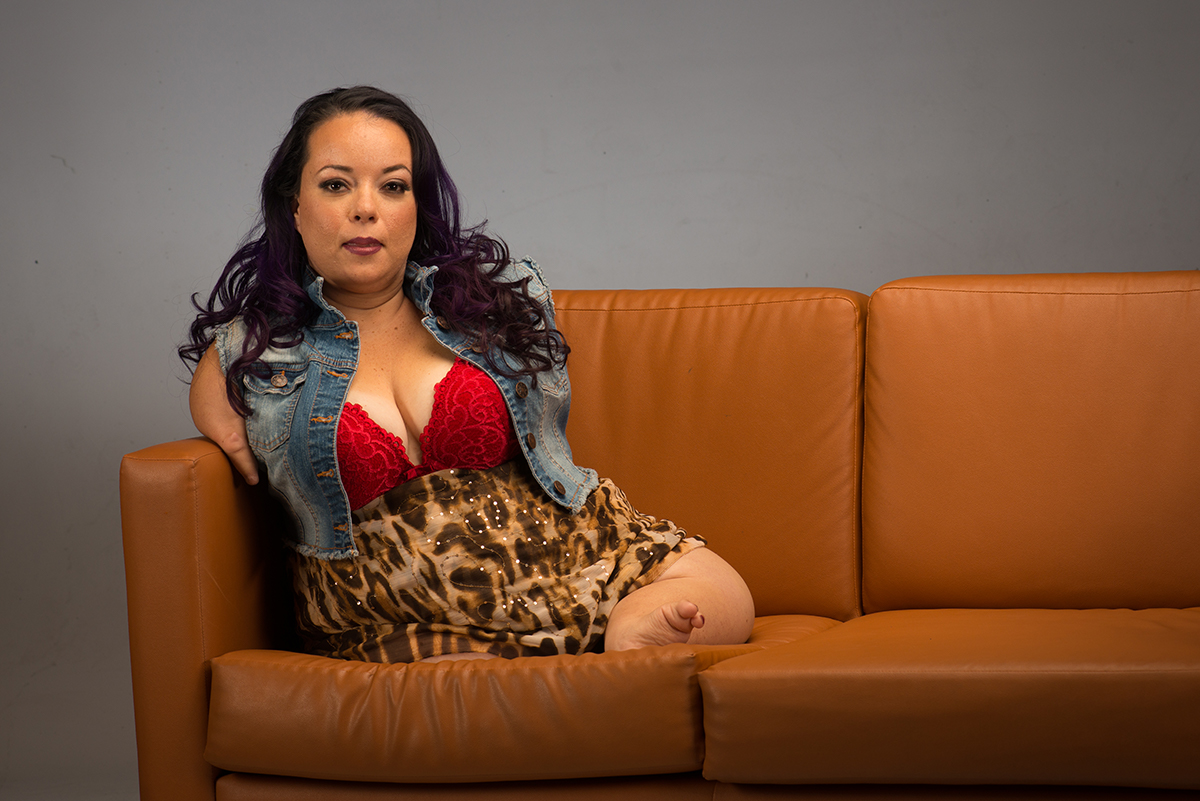 Josette Ulibarri sitting on a couch.