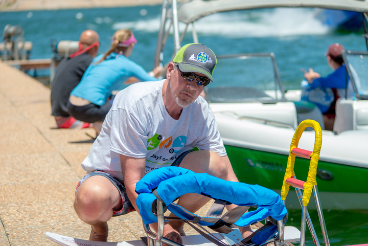 Jeff Ramsdell holds adaptive waterskis