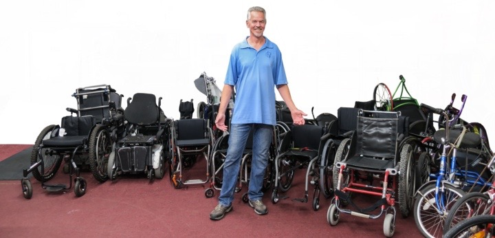 Jeff Ramsdell with adaptive wheelchairs in background