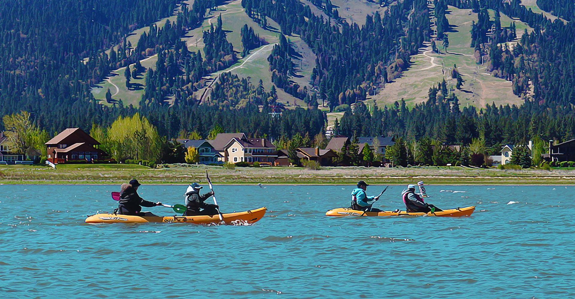 2 orange 2-person kayaks on Big Bear Lake. Mountains and lake houses in the background.