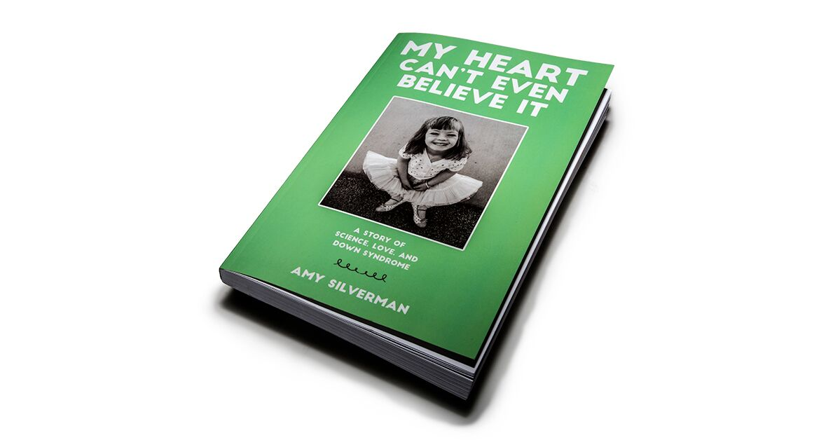 A green book entitled My Heart Can't Even Believe It by Amy Silverman
