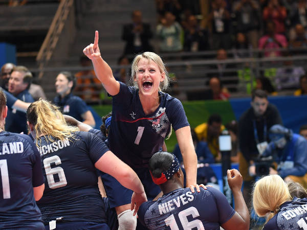 Sitting Women's Volleyball gold medalist Lora Webster celebrates her victory