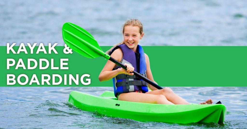 Kayak and Paddleboarding. Young girl paddling on a Kayak.