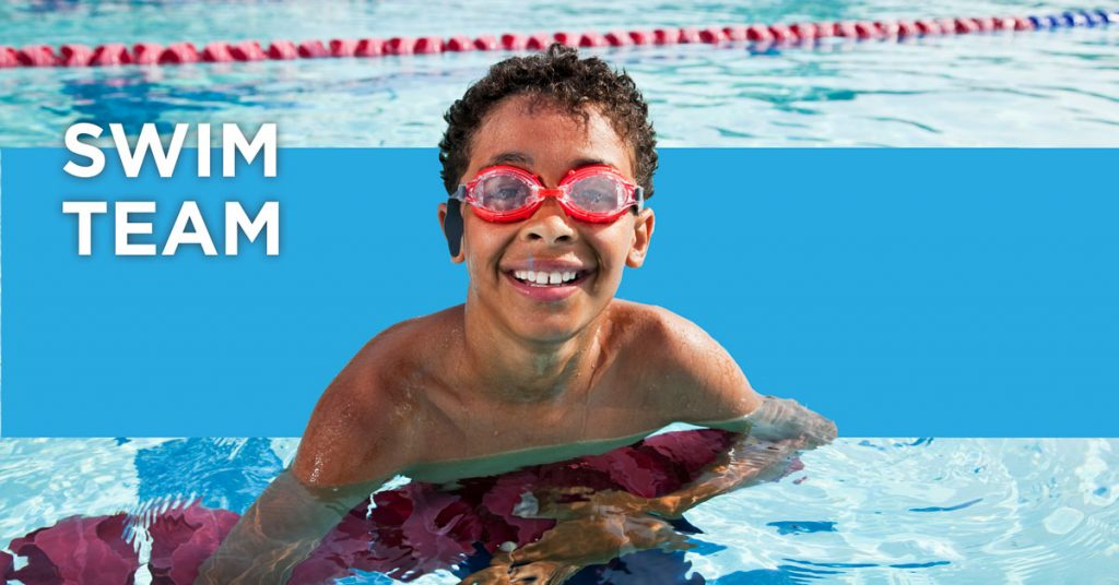 Swim Team. Young boy wearing water goggles in the pool.