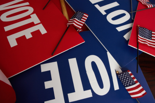 Image of voter registration cards and small decorative flags