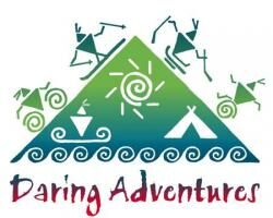 The logo for the Daring Adventures Company. It is a triangle with a blue-green gradient and silhouettes of people doing sports.