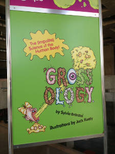 A lime green poster for the Grossology exhibit