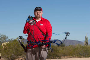 Paralympian Eric Bennett holds his bow