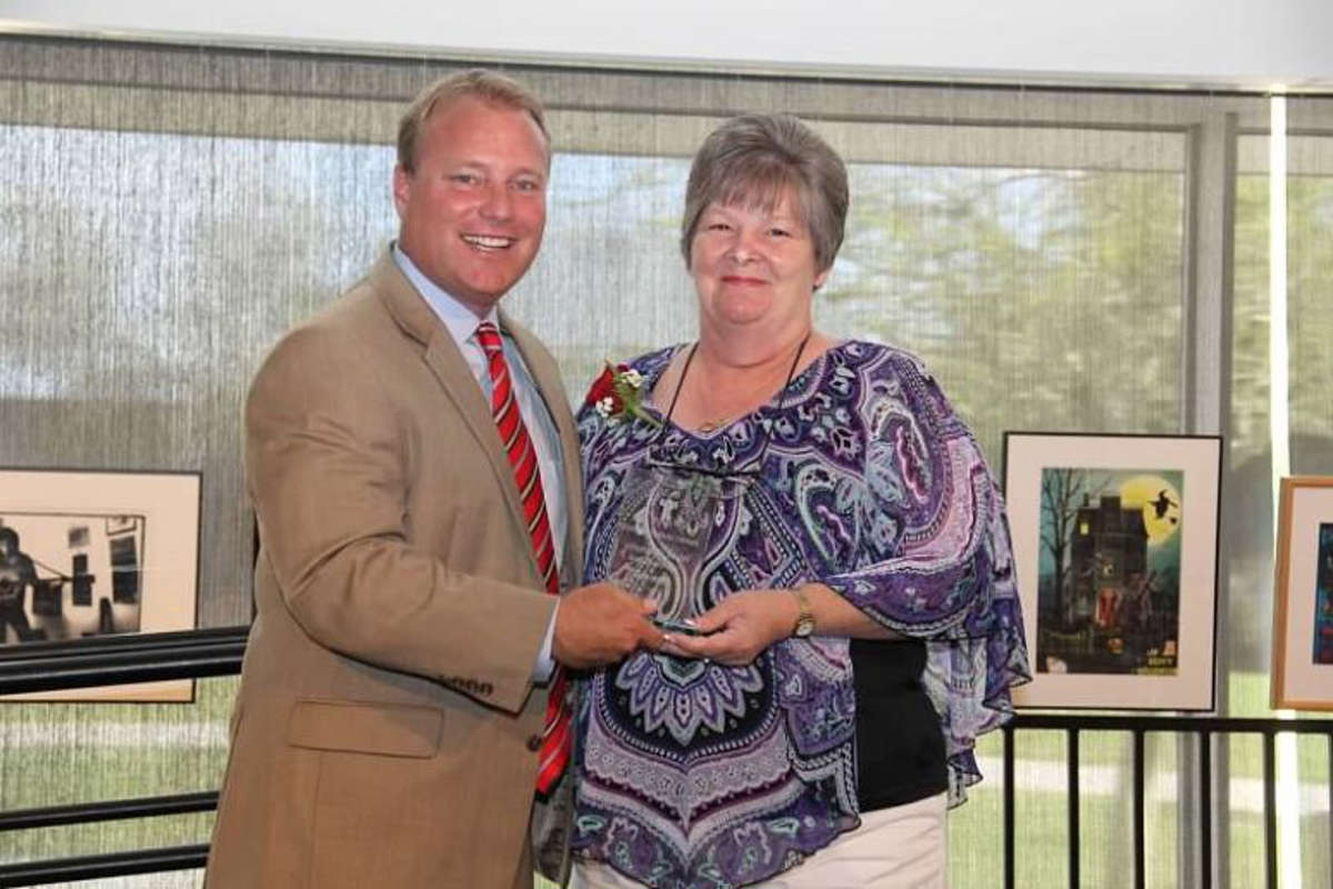 Terri Guy holds her Valued Community Service award and poses with Tempe Mayor Mark Mitchell