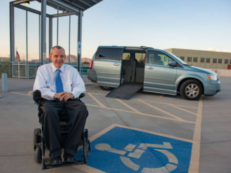 Phil Pangrazio on front of accessible van parked in an accessible spot.