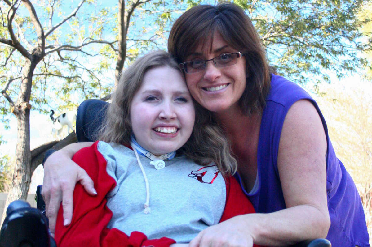 Alyssa and Ability360 Caregiver Maria smile for the camera.