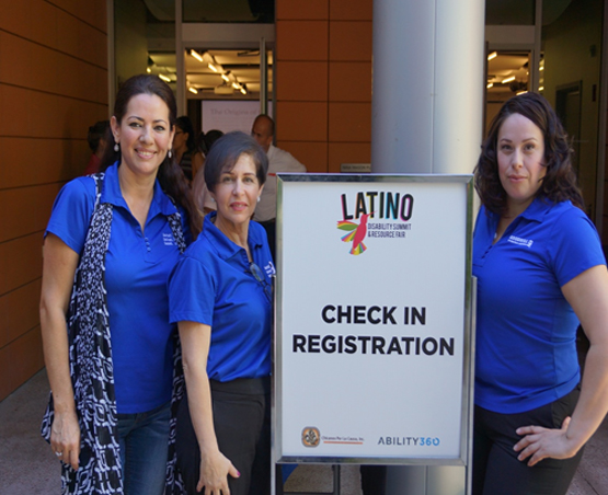 Group of people at the registration table at the Latino Disability Summit 2016