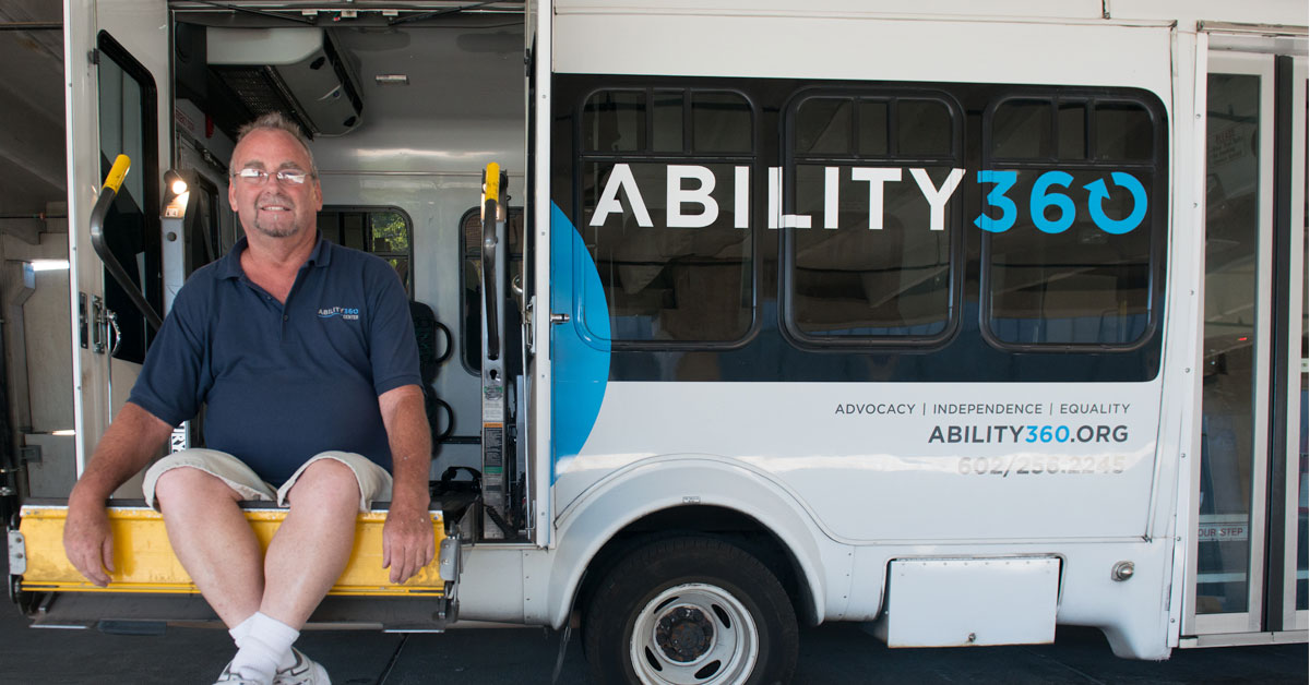 Daniel Mueller sits in an Ability360 accessible van.