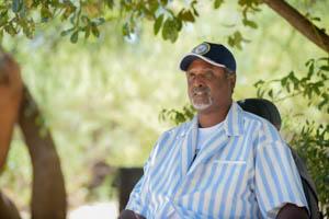Markus Davis sits at Boyce Thompson Arboretum.