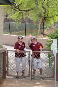 Dorla Newell and Chance Summers stand by a gate.