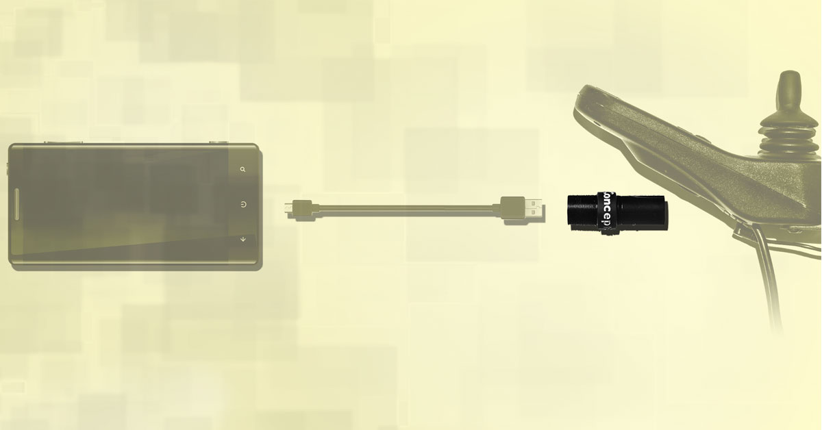 An illustration of a power wheelchair arm with the joystick. The phone charger is about the size of a black tube of lipstick. Illustration shows where it plugs into wheelchair charger. A phone charging card is faded in the background.