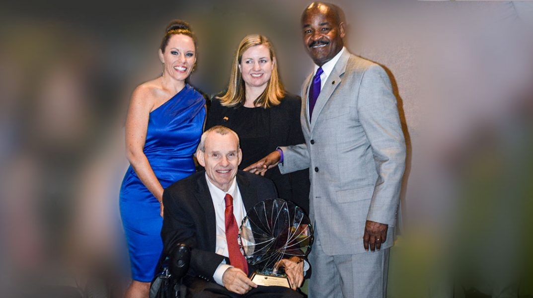 Phil Pangrazio holds award and poses with Don Logan, Kate Gallego and Nohelani Graf