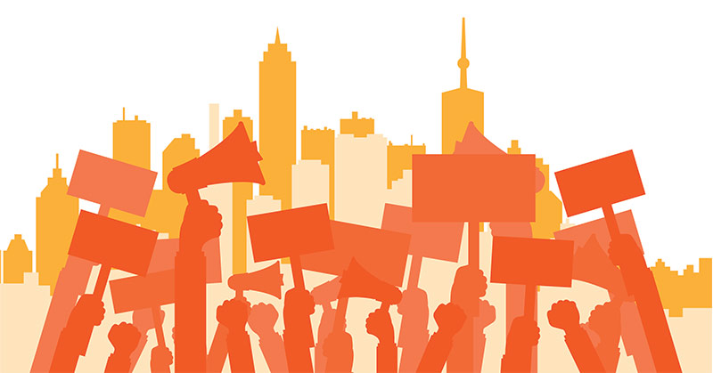Illustration shows an orange skyline and in the foreground shows the orange shadows of protest signs, megaphones, and hands raised in protest.