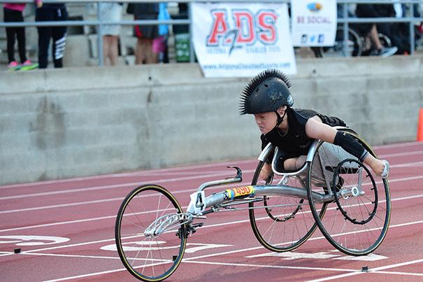 Zack, racing in his 3 wheel racing chair