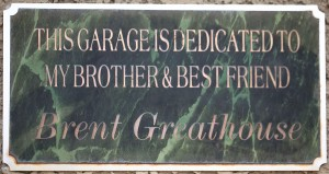 Green sign that says this garage is dedicated to my brother and best friend Brent Greathouse