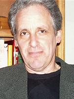 Steve Car in front of a bookshelf