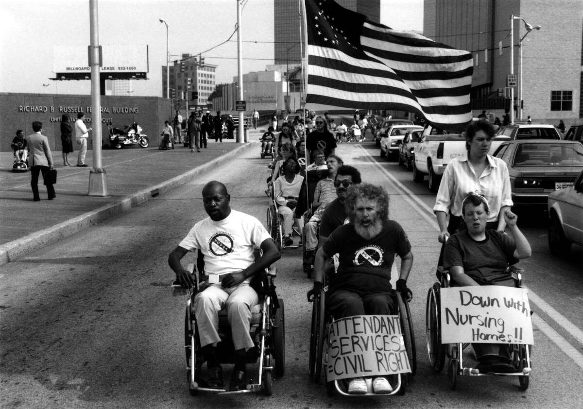 Bob Kafka leads ADAPT activists in a demonstration for home and community based services in Georgia