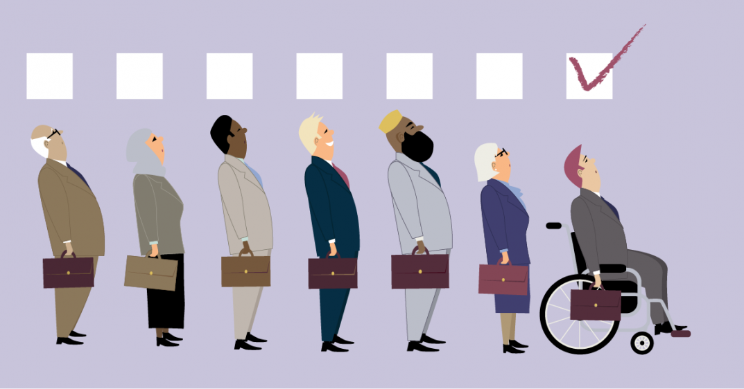 Cartoon people of all ethnicities and genders stand in a line with boxes above their heads. All of the people are dressed in business attire and hold briefcases in their right hand. They are all being interviewed for the same position. A man sitting in a wheelchair is at the front of the line. The box above his head has a red check mark, suggesting he has been chosen for the job.