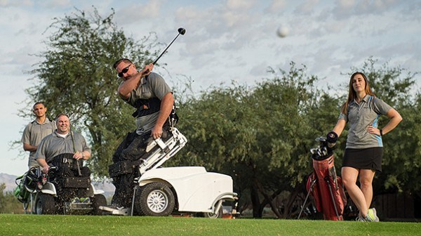 Jason Graber swings his golf club using his Stand Up and Play wheelchair.