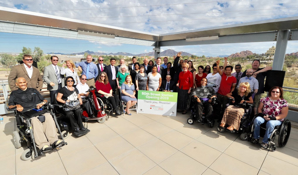 Advocates of disability rights celebrate the new light-rail station at 50th and Washington streets.
