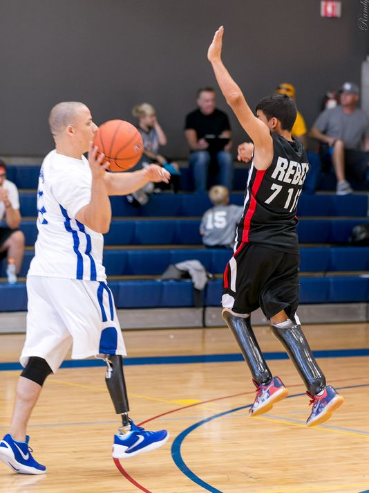 Stephen Hernandez plays defense in a game of amputee basketball.