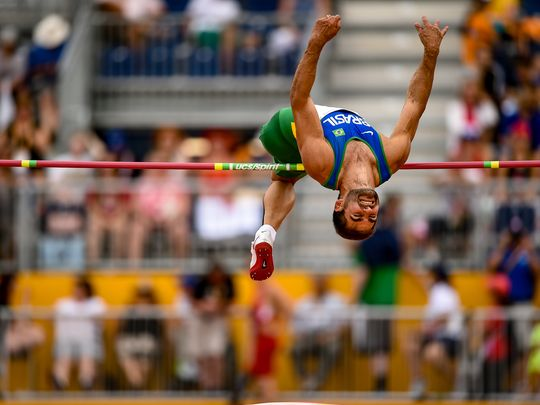 A high jumper at the 2015 Parapan Games in Toronto flies over a pole.