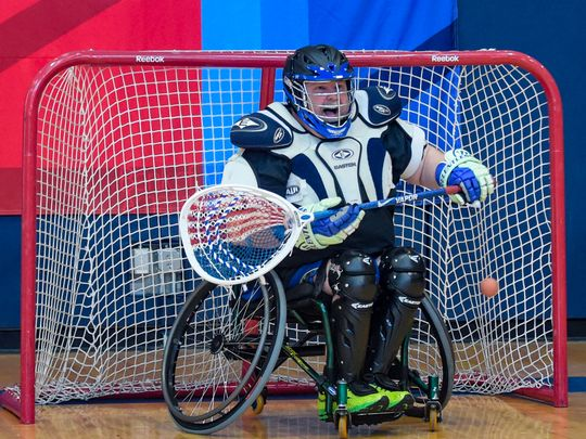Tim Surry playing as the goalie in a game of wheelchair lacrosse