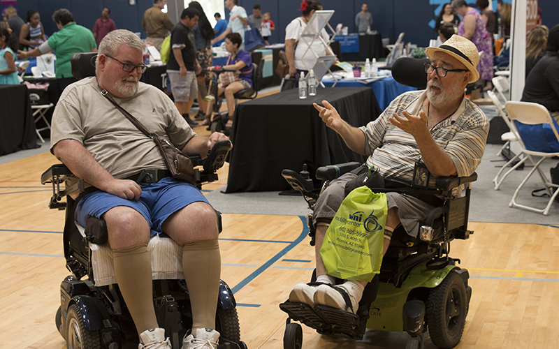 Jose Ortiz-Reyes sings song with Timothy Rowse at Latino Disability Summit and Resource Fair