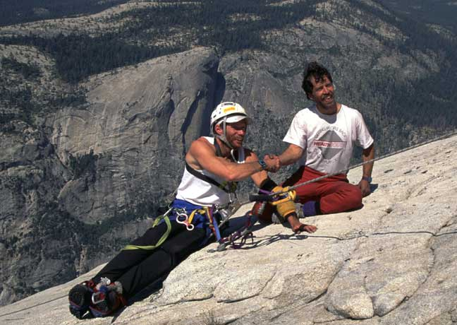 Mark Wellman and his climbing partner rest at the summit.