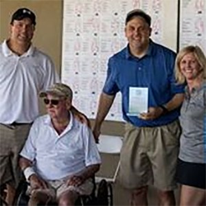 Sitting is Ted Welty, a participant of the 360 Charity Golf Tournament.