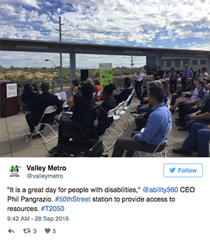 "A photo of people gathered on the roof. The tweet from Valley Metro reads, ""'It is a great day for people with disabilities' @ability360 CEO Phil Pangrazio. #50thStreet station to provide access to resources. #T2050"