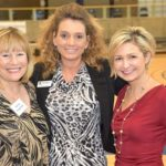 Three women pose for a photo at this Ability360 event.