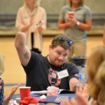 A man raises his amputated arm at this Ability360 event.