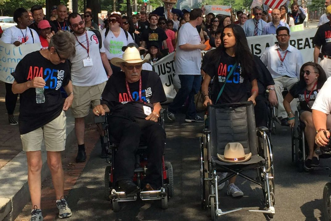 People with disabilities march to the US Capitol to meet with a Congressional delegation.