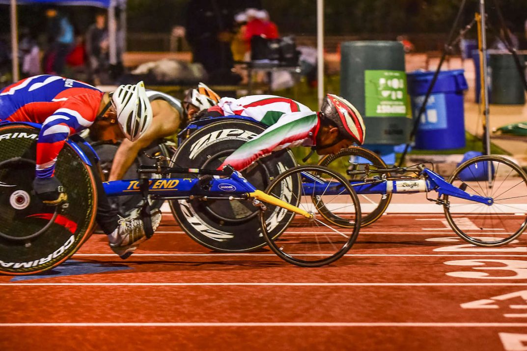 Wheelchair racers compete on a track.