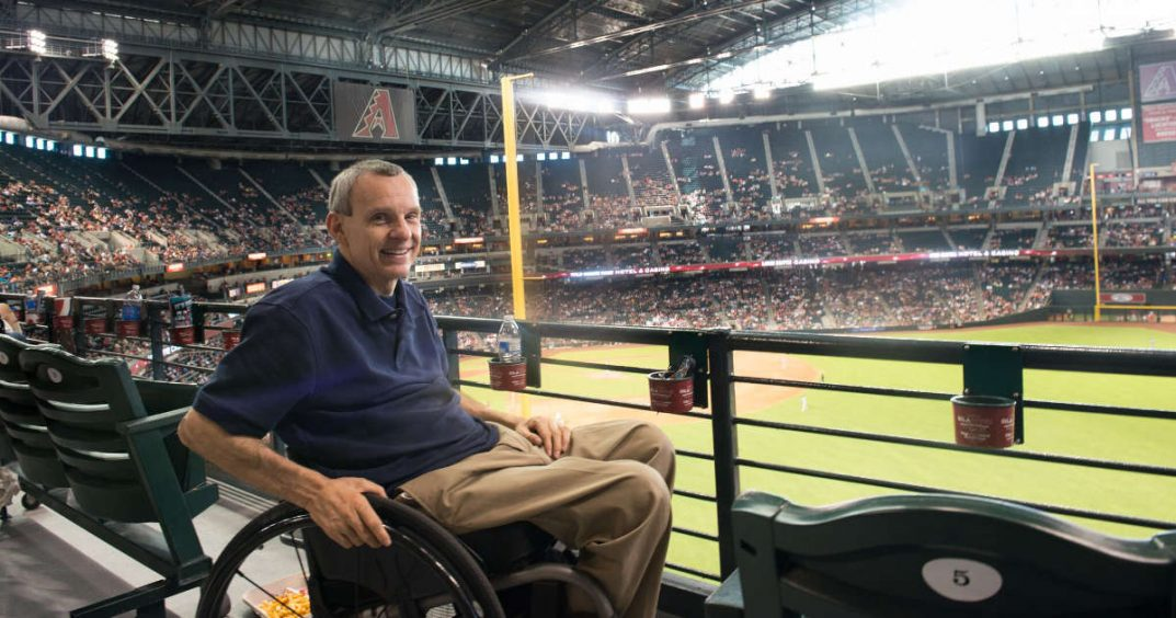 PHOTO: Ability360 President Phil Pangrazio sits in the crowded Chase Field baseball stadium.
