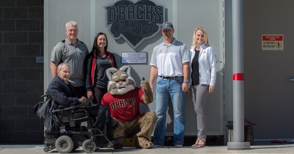 Photo: Ability360 CEO Phil Pangrazio, Sports and Fitness Center staff and staff from the AZ Diamondbacks pose with a mascot. Phil Pangrazio uses a power chair.