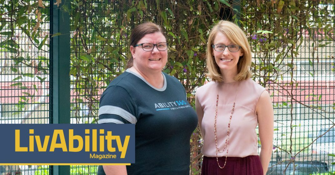 Photo. Sarah Olson and April Reed smile for the camera in front of a lattice with vines. Sarah wears a gray Ability360 shirt. She wears glasses and a ponytail. April on the right wears a pink sleeveless shell with necklace. She wears glasses and her blonde hair is down.