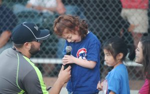 Abby Sosnow sings during the seventh-inning stretch at the Dan Haren Miracle League Field in Scottsdale. (Photo by Caela Fox/Cronkite News)