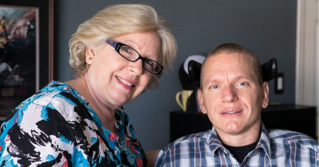 Caregiver Susan Shields and her son Michael pose for the camera.