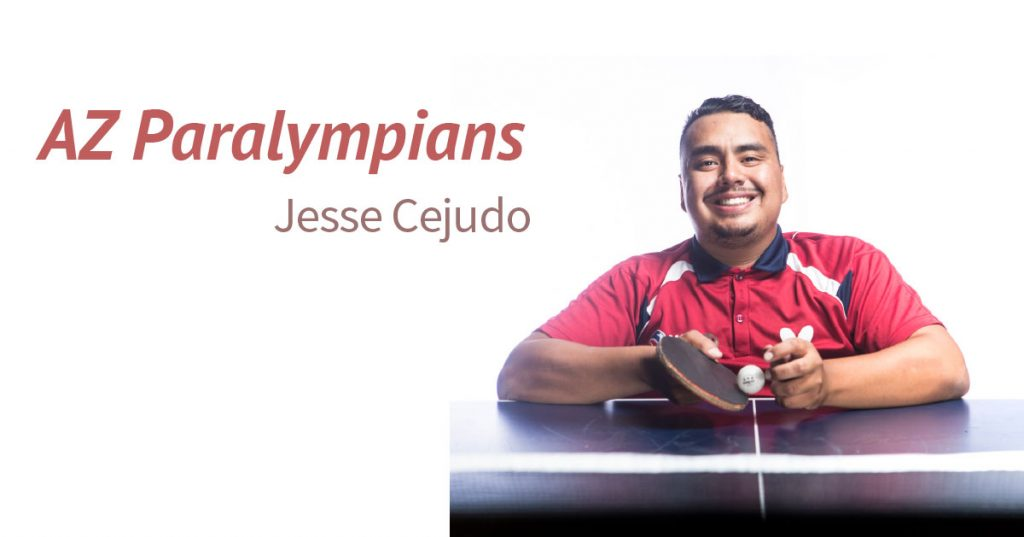 Text: AZ Paralympians Jesse Cejudo. Image: Jesse Cejudo smiles at the camera. He wears a red polo shirt and holds a table tennis paddle and ball.