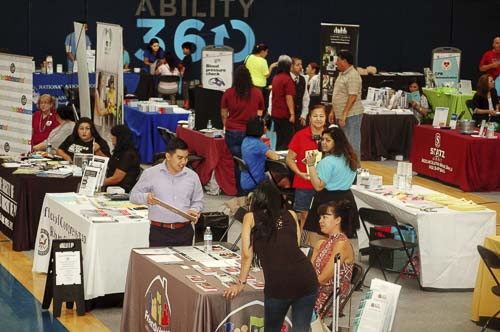Latino Recap shows a photo montage of the event. Photo one shows exhibitors on the floor. Several rows of tables surrounded by attendees.